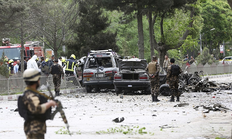 Security forces inspect at the site of a suicide attack in Kabul.— AP