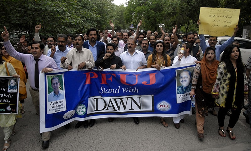 Demonstrators from the Pakistan Federal Union of Journalists and Rawalpindi-Islamabad Union of Journalists march from Dawn's Islamabad office to the Press Information Department on Wednesday to express solidarity with the newspaper.— Photo by Mohammad Asim