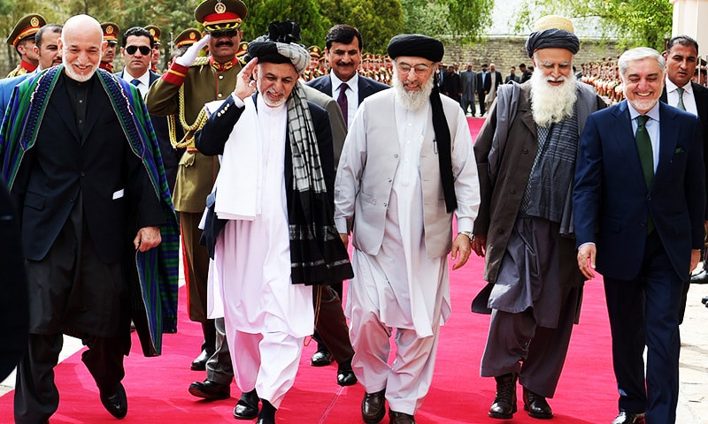 Former Afghan president Hamid Karzai, Afghan President Ashraf Ghani, Gulbuddin Hekmatyar, former warlord Abdul Rabb Rasool Sayyaf and Afghan Chief Executive Abdullah Abdullah walk to attend a ceremony at the Presidential palace.—Reuters