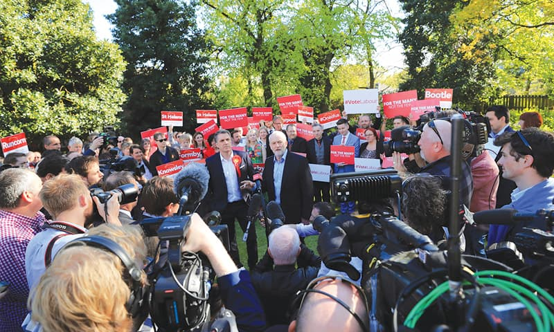 Liverpool: Media and party supporters gather around Labour Party leader Jeremy Corbyn (centre right) meeting Steve Rotheram (centre left) after he was elected as the Liverpool City Region metro mayor on Friday.—AP