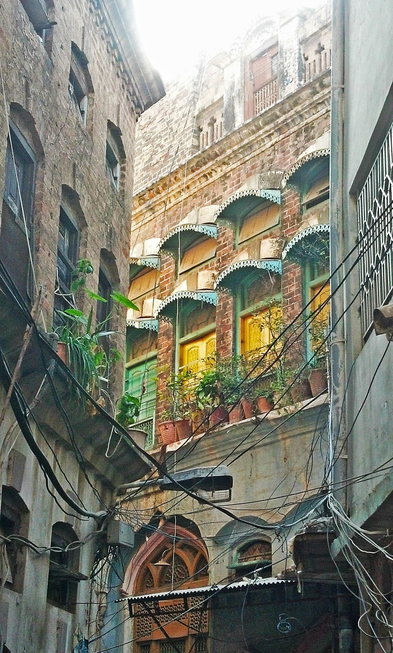 Walking through the streets near Shah Chan Charagh, which is attached to the Sarafa Bazaar.