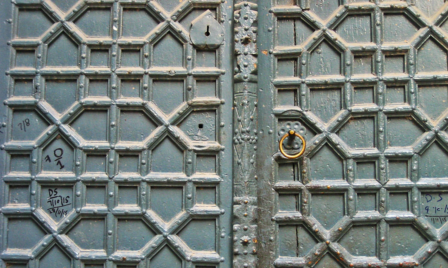 Detailed carvings of an old, wooden door.