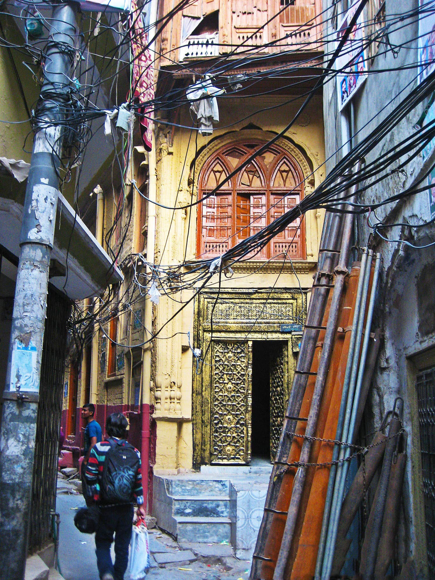 Narrow passageways with façades of old houses.