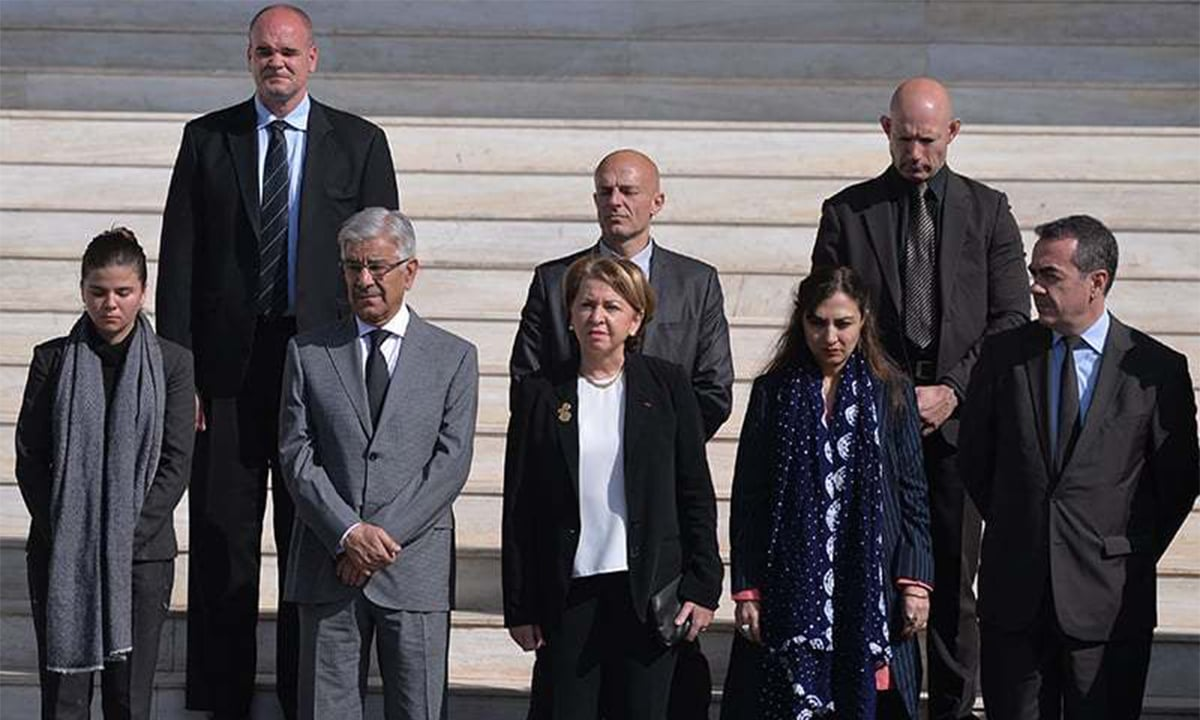French ambassador to Pakistan Martine Dorance, Khawaja Asif and staff members at the French Embassy in Islamabad | AFP