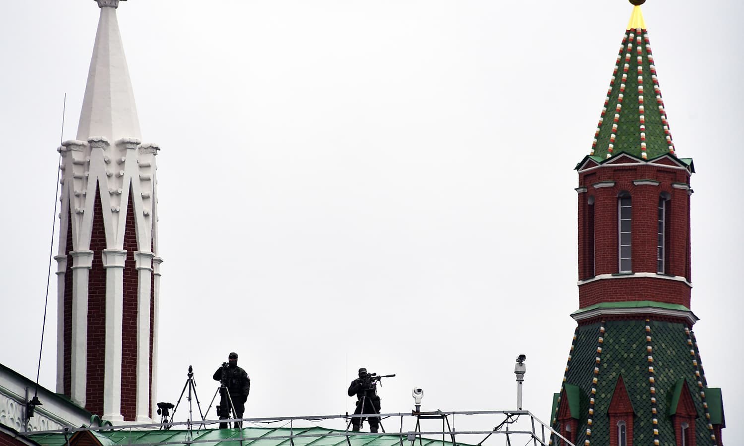 Snipers secure the area during the Victory Day military parade at Red Square in Moscow. -AFP