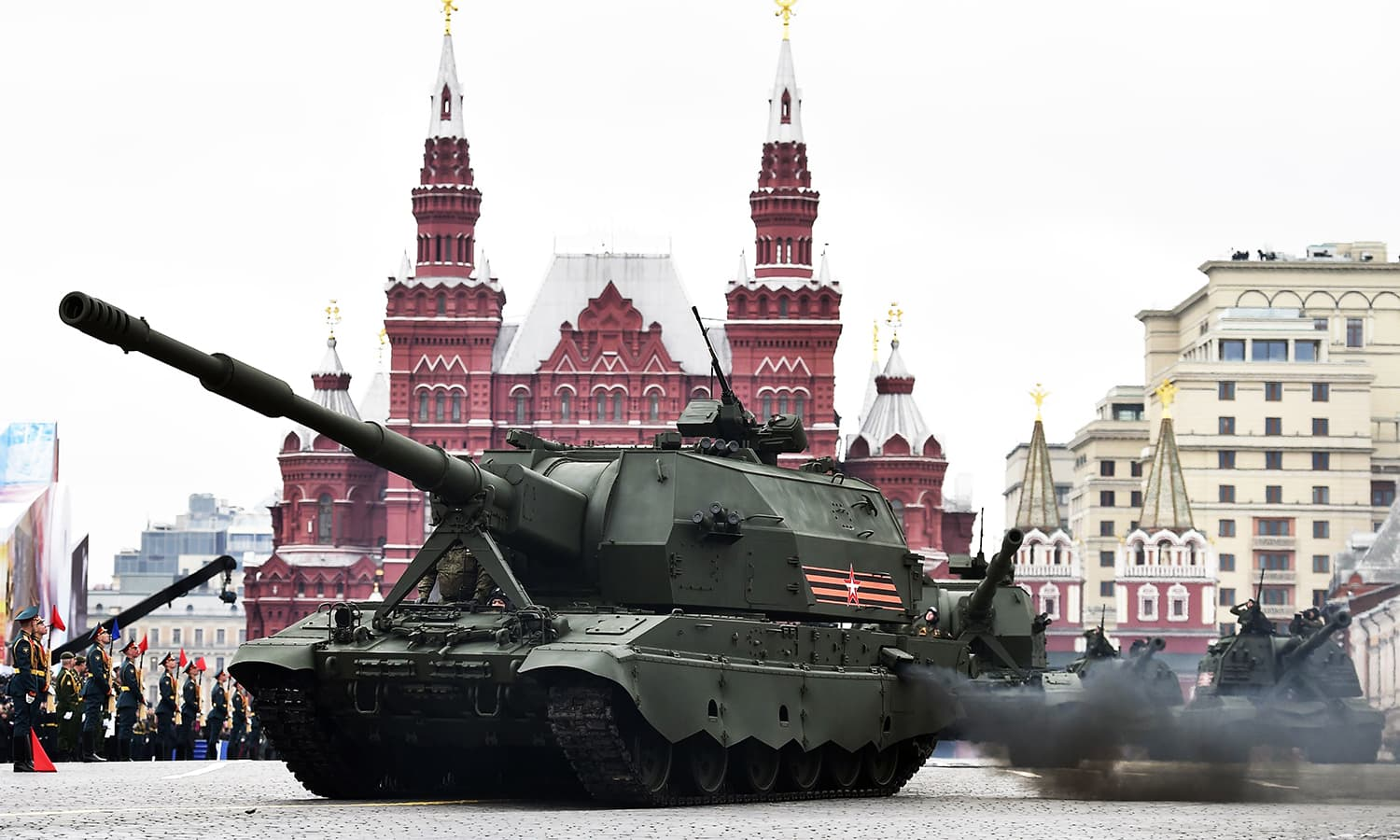 Koalitsiya-SV self-propelled howitzers ride through Red Square. -AFP