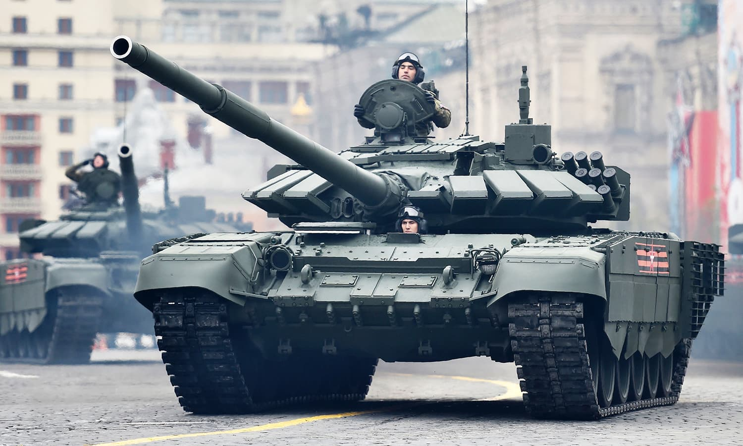 Russian T-72B3 main battle tanks ride through Red Square. -AFP