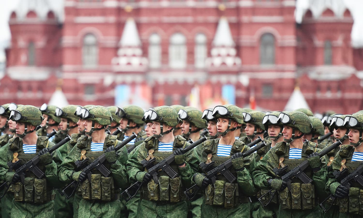 Russian servicemen march at Red Square during the Victory Day military parade. -AFP