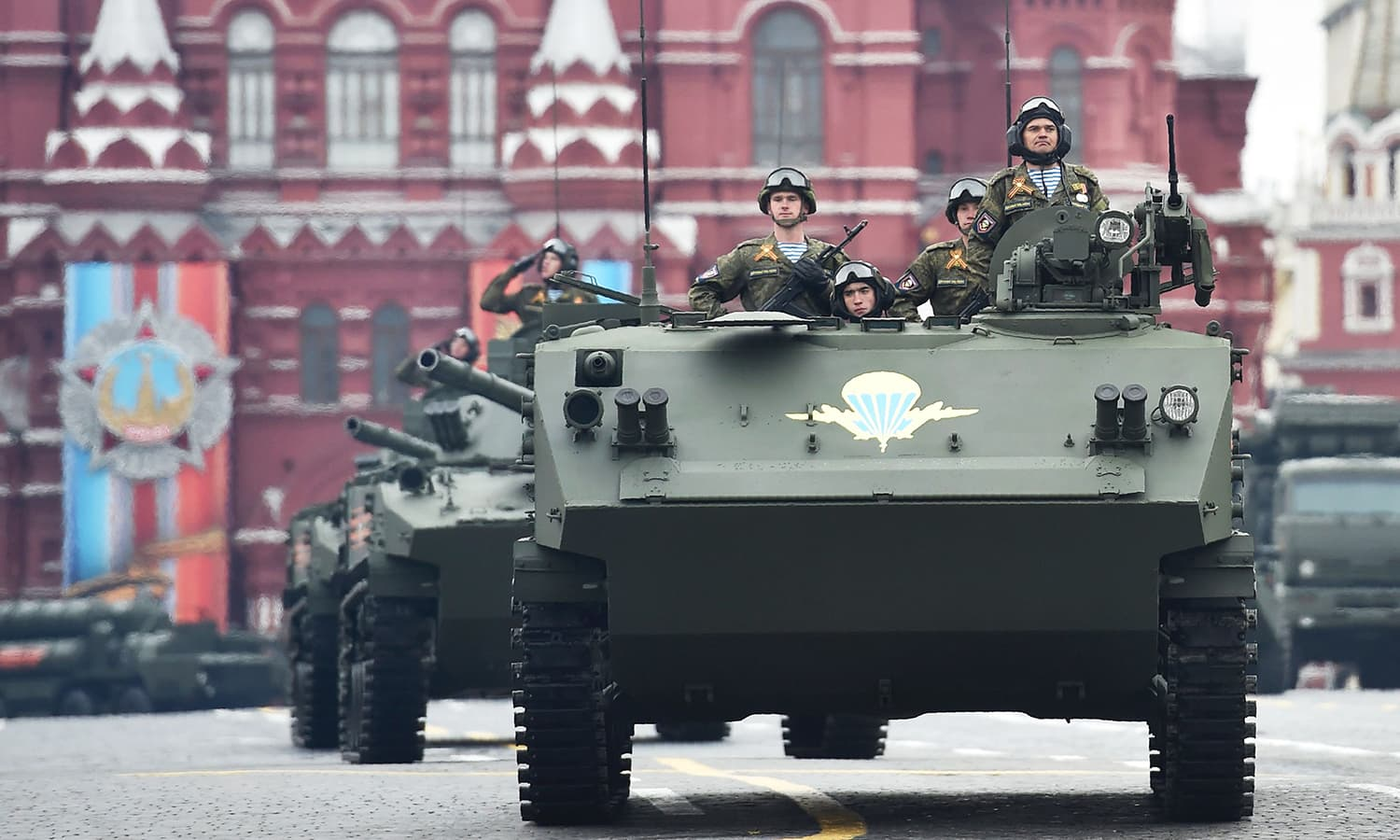 A BTR-MDM Rakushka airborne armoured personnel carrier and BMD-4M Sadovnitsa infantry fighting vehicles ride through Red Square. -AFP