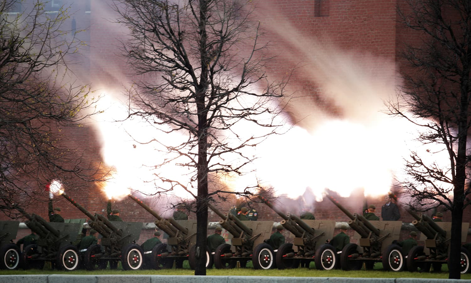 Russian artillery fires in salute during the Victory Day military parade. -Reuters