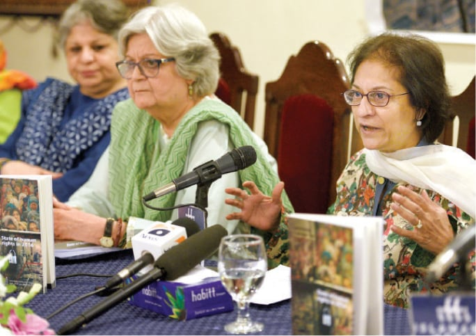 HRCP's Asma Jahangir, flanked by Salima Hashmi, speaks at the report launch on Wednesday. — White Star