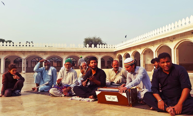 *Qawwals* performing at Bulleh Shah's shrine.