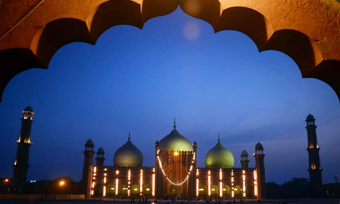 An illuminated view of Badshahi Mosque decorated with colorful lights on the eve of Shab-i-Barat. —Online