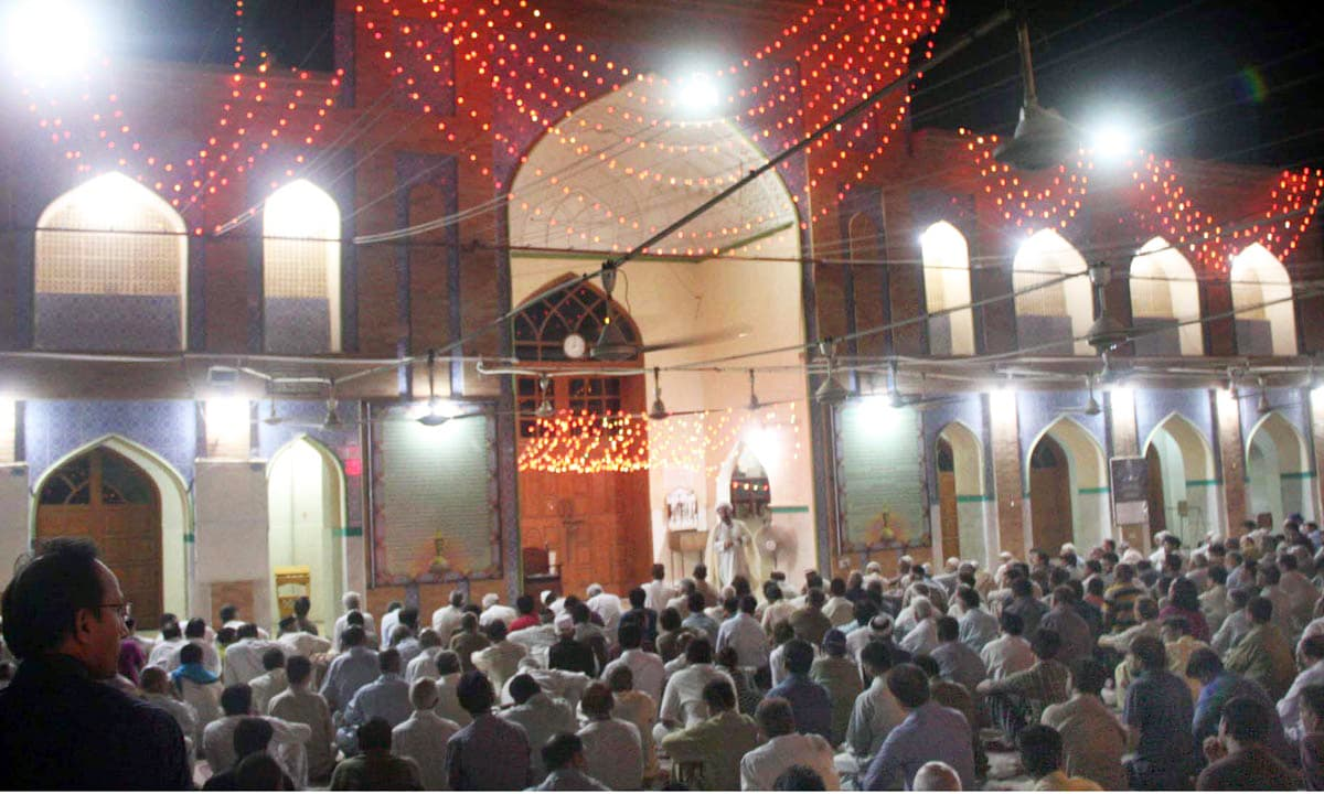 People attend a sermon at a mosque in Karachi. —Online