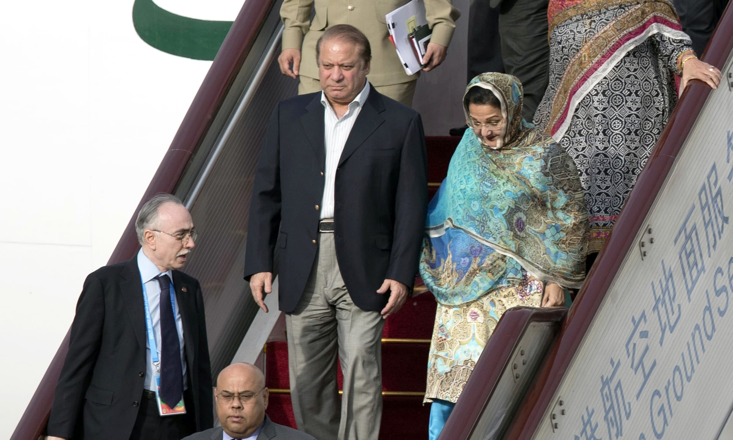 PM Nawaz Sharif and his wife Kalsoom Nawaz reach Beijing. —AP