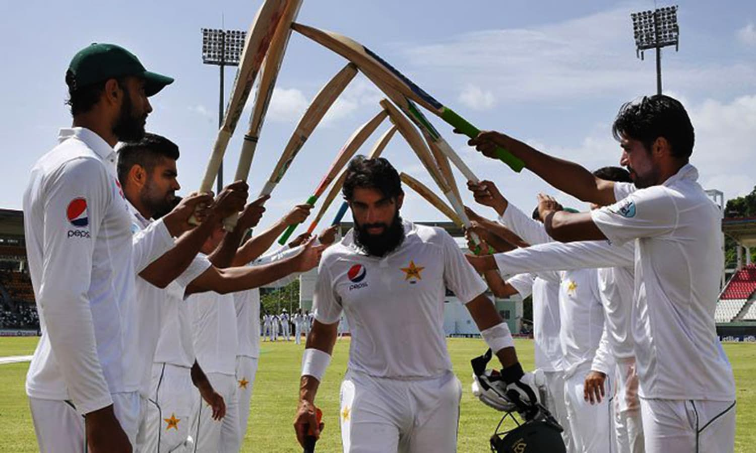 Misbah walks through a 'guard of honour' as he exists the field after his final international Test inning as a batsman.  — ICC's Twitter