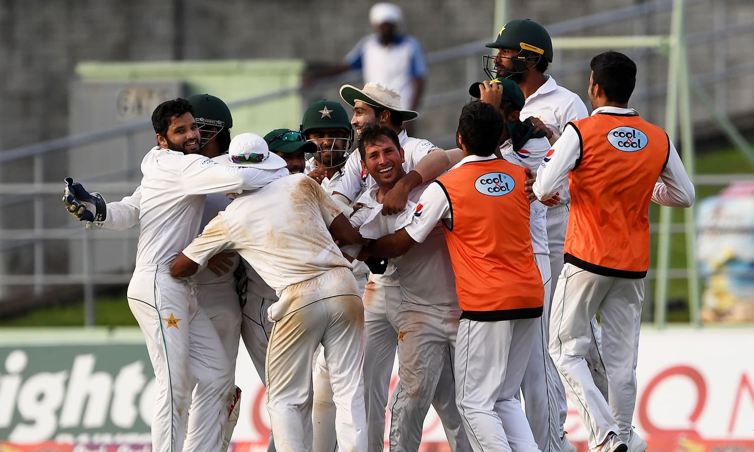 The team celebrates the fall of another wicket as they inched closer to the win. — AFP
