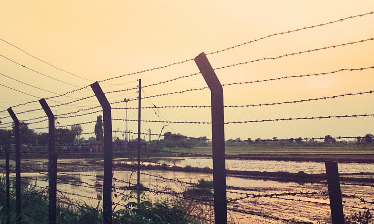 A fence marking a part of the India-Pakistan border | Photo by Abhishek Baxi, Flickr