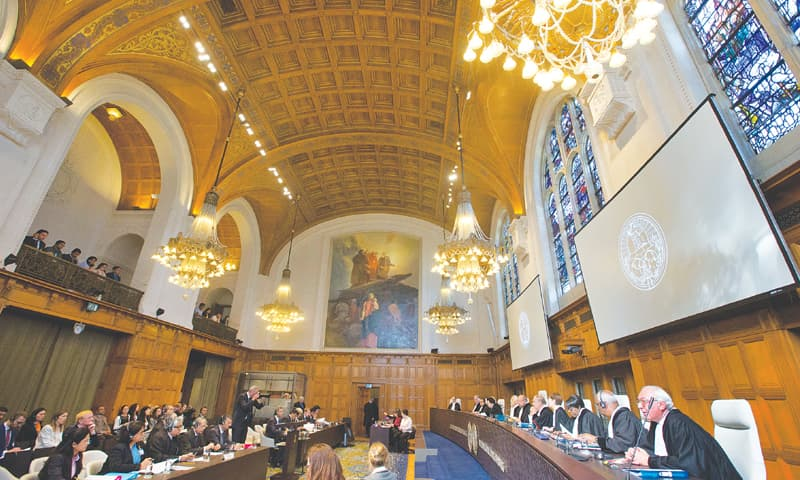 THE HAGUE: Delegations of Pakistan (second table left) and India listen to judges at the International Court of Justice on Monday.—AP