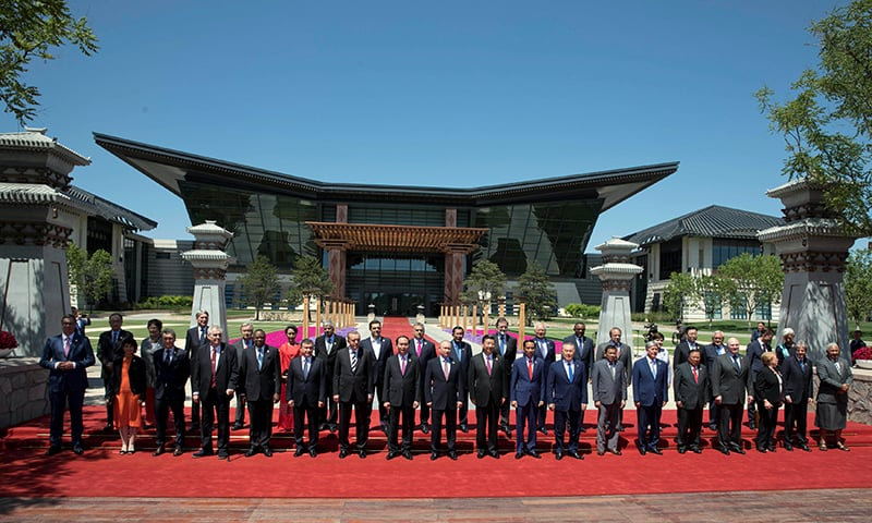 Leaders attending the Belt and Road Forum pose for a group photo at the Yanqi Lake venue on the outskirt of Beijing, China — Reuters