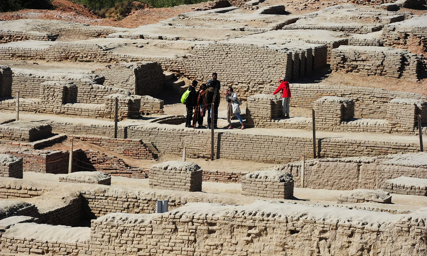 Visitors carelessly tread on the ancient ruins. — AFP