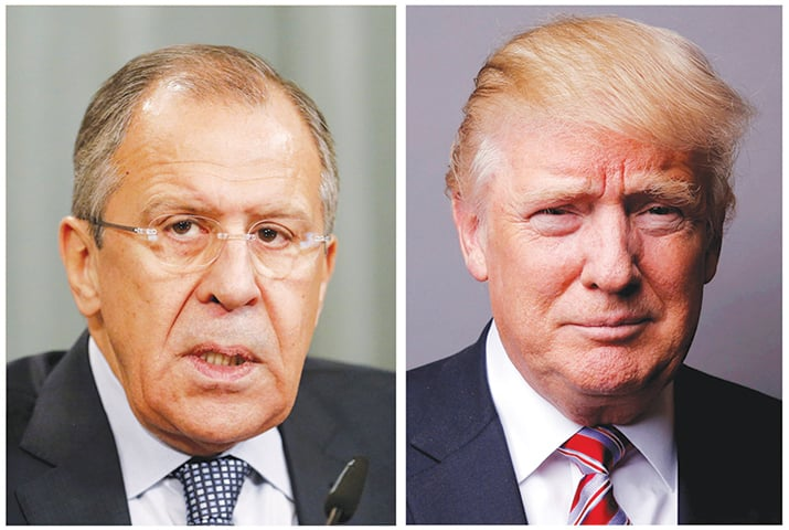 Donald Trump is in the line of fire for intel sharing with Russain Foreign Minister Sergei Lavrov (left).—Reuters