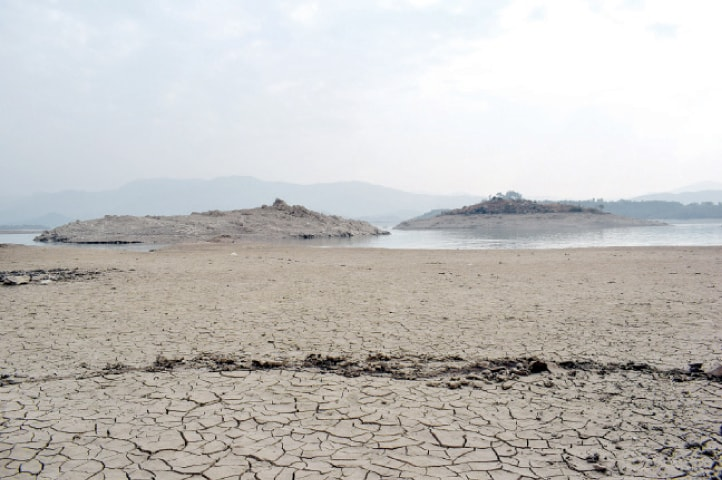 A view of the dried up Khanpur Dam. — Dawn