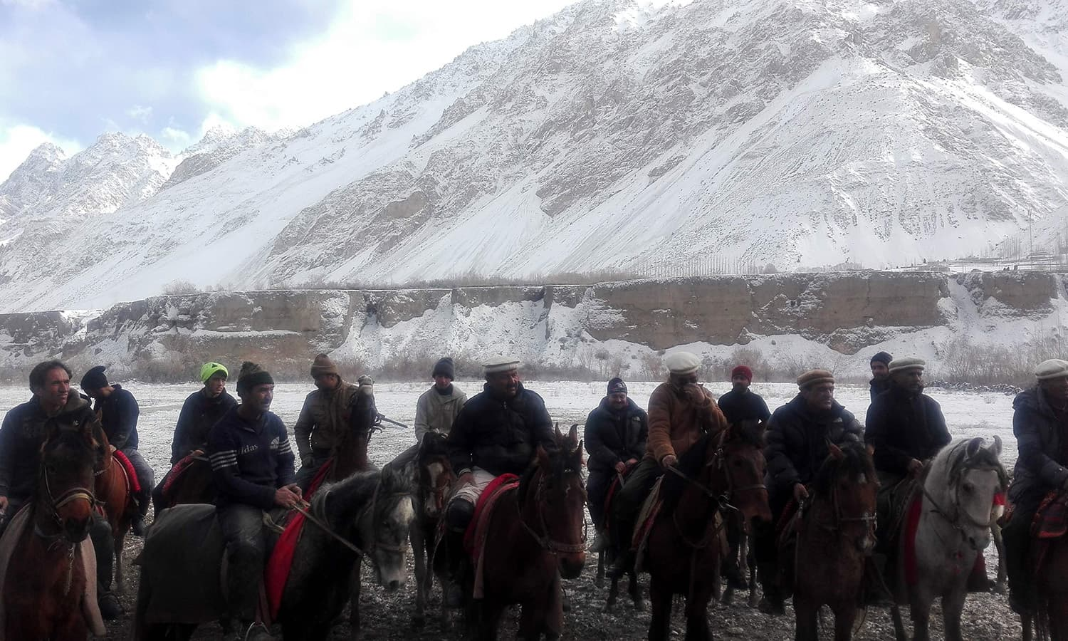 Horsemen prepare for a traditional game of Buzkashi in snow covered Chapursan village of Hunza Valley.─AFP