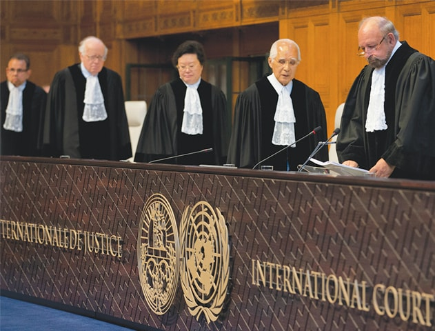 THE HAGUE (The Netherlands): Presiding judge Ronny Abraham of France (right) prepares to read the International Court of Justice's verdict in the Kulbhushan Jadhav case on Thursday.—AP