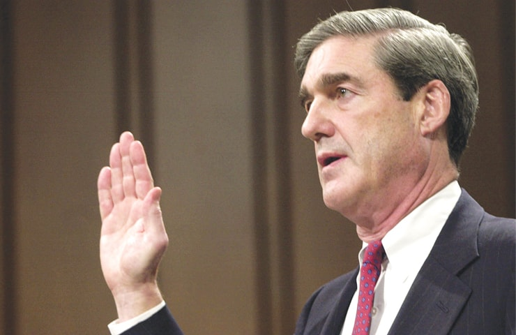 Robert Mueller is sworn in at the start of his testimony during his confirmation hearing before the Senate Judiciary Committee on Capitol Hill in Washington to be the FBI director on July 30, 2001. Mueller took office as FBI director in 2001 expecting to dig into drug cases, white-collar misdeeds and violent crime. A week later was Sept 11. Overnight, his mission changed and Mueller spent the next 12 years wrestling the agency into a battle-hardened terrorism-fighting force.—AP