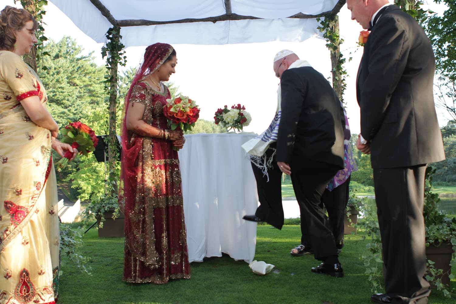 John Kravitz breaks the glass at the wedding ceremony. His bride is dressed in South Asian bridal attire. — Photo courtesy Amara Chaudhry Kravitz