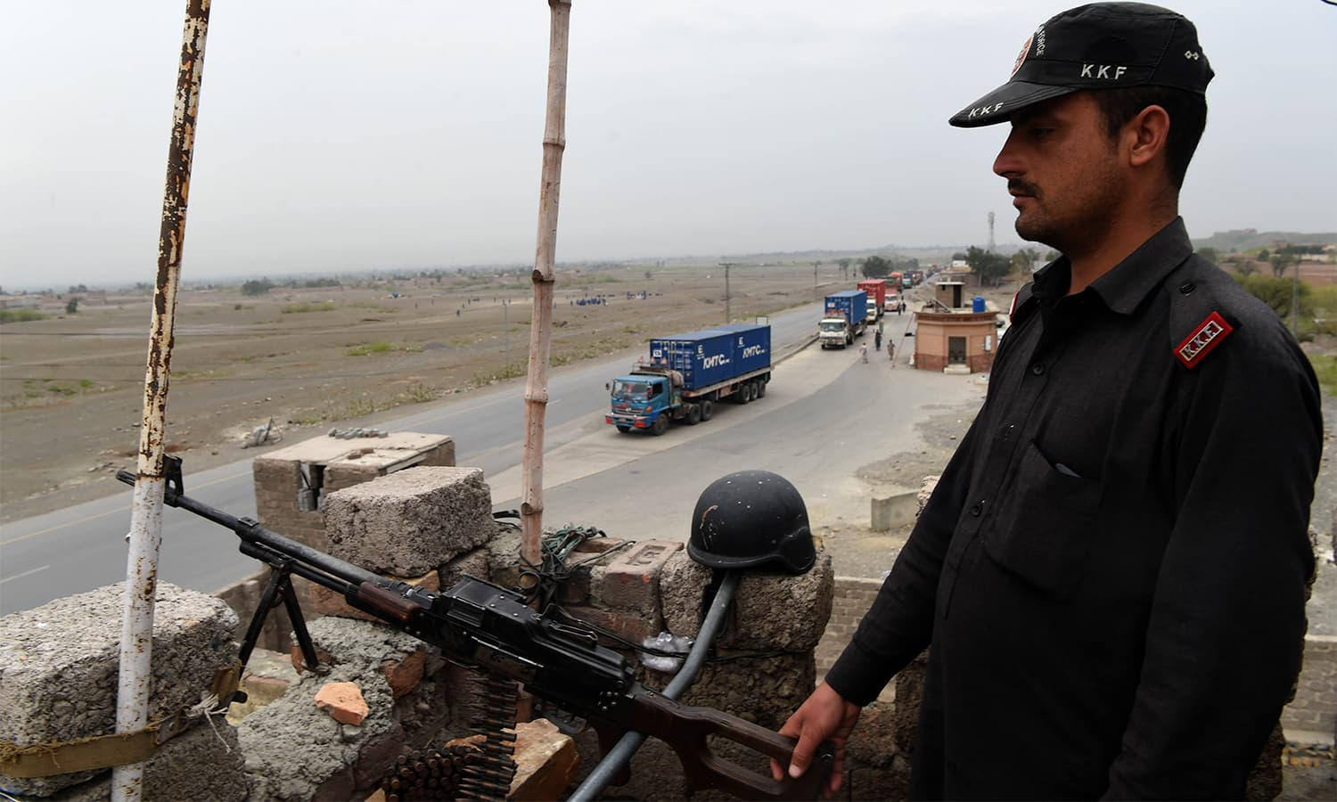 Security personnel standing guard at a checkpoint in the Jamrud town of Khyber Agency in KP.