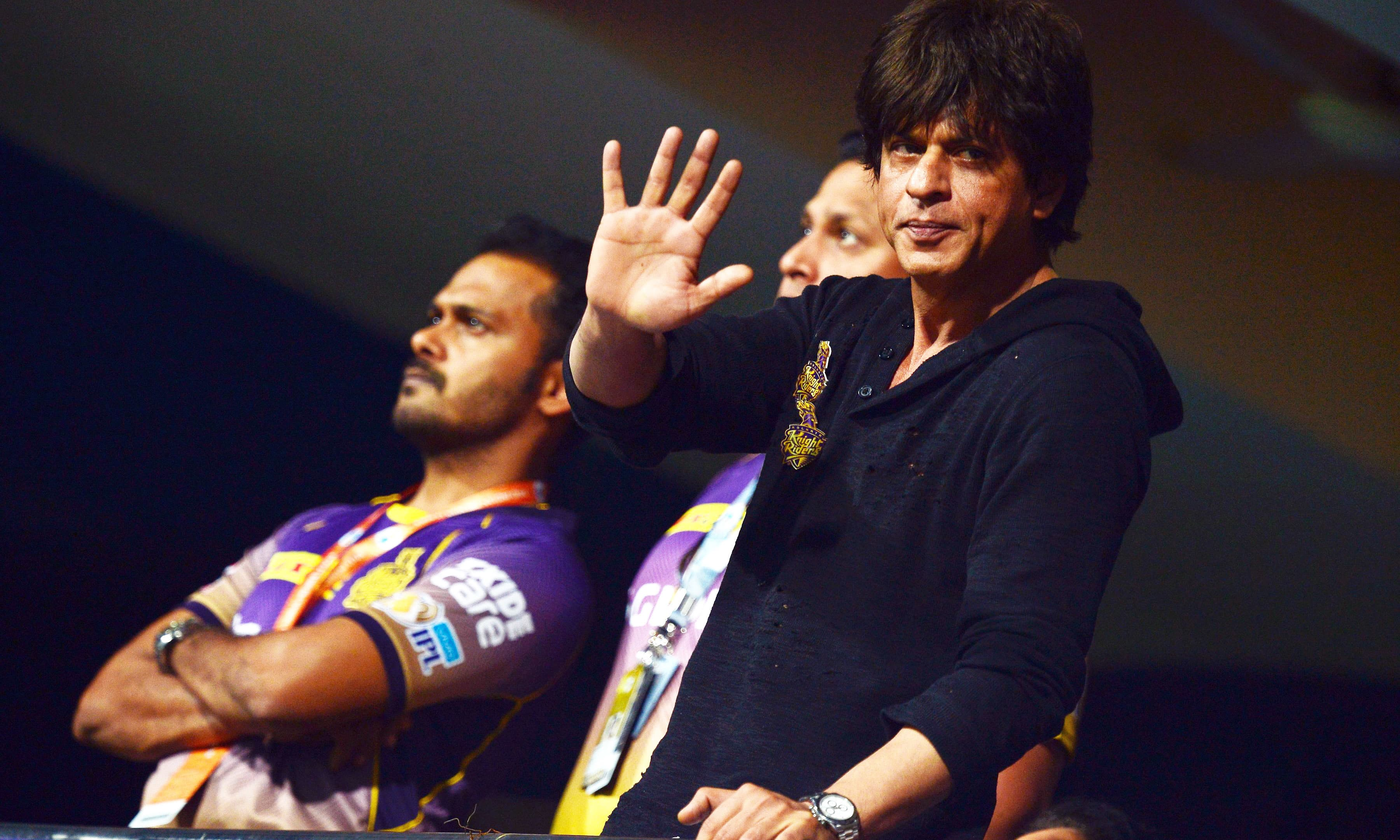 Shah Rukh Khan waves to supporters during the 2017 IPL match. —AFP