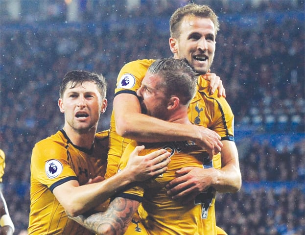 TOTTENHAM Hotspur's Harry Kane (top) celebrates after scoring against Leicester City.—AP
