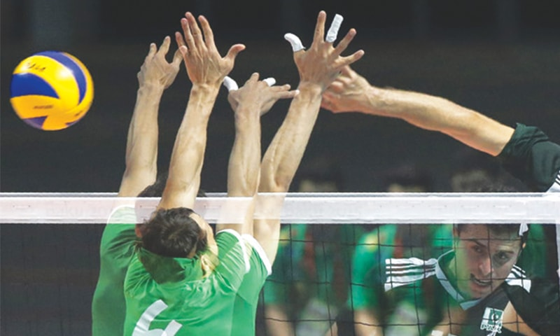 IN this multi-exposure shot taken on Friday, Pakistan's Murad Jehan (R) smashes the ball during the volleyball match against Turkmenistan at the Crystal Hall Arena.—AFP
