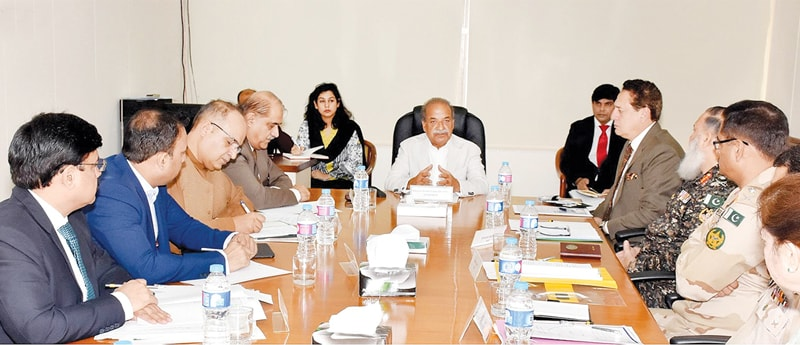 ISLAMABAD: Adviser to the Prime Minister on Aviation Sardar Mehtab Abbasi chairing a meeting on Friday.—INP