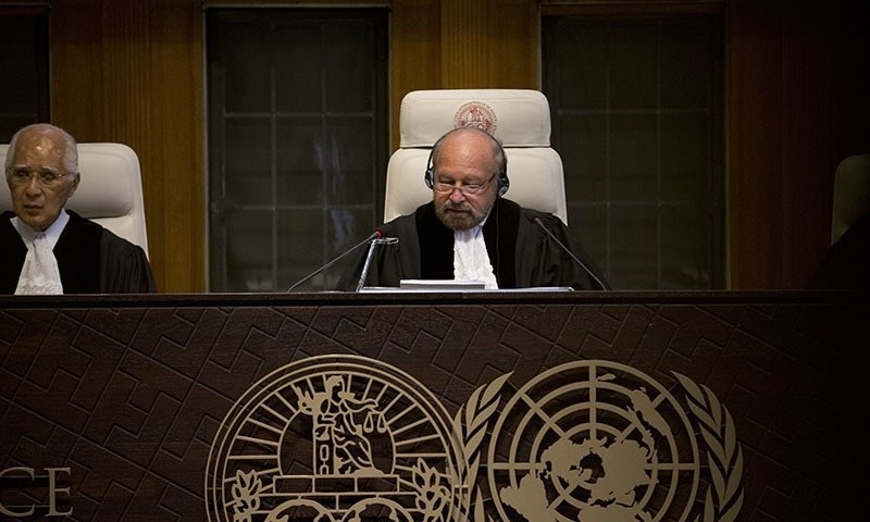 Presiding judge Ronny Abraham of France, center, reads the World Court's verdict in the case brought by India against Pakistan in The Hague, Netherlands, Thursday, May 18. ─ AP