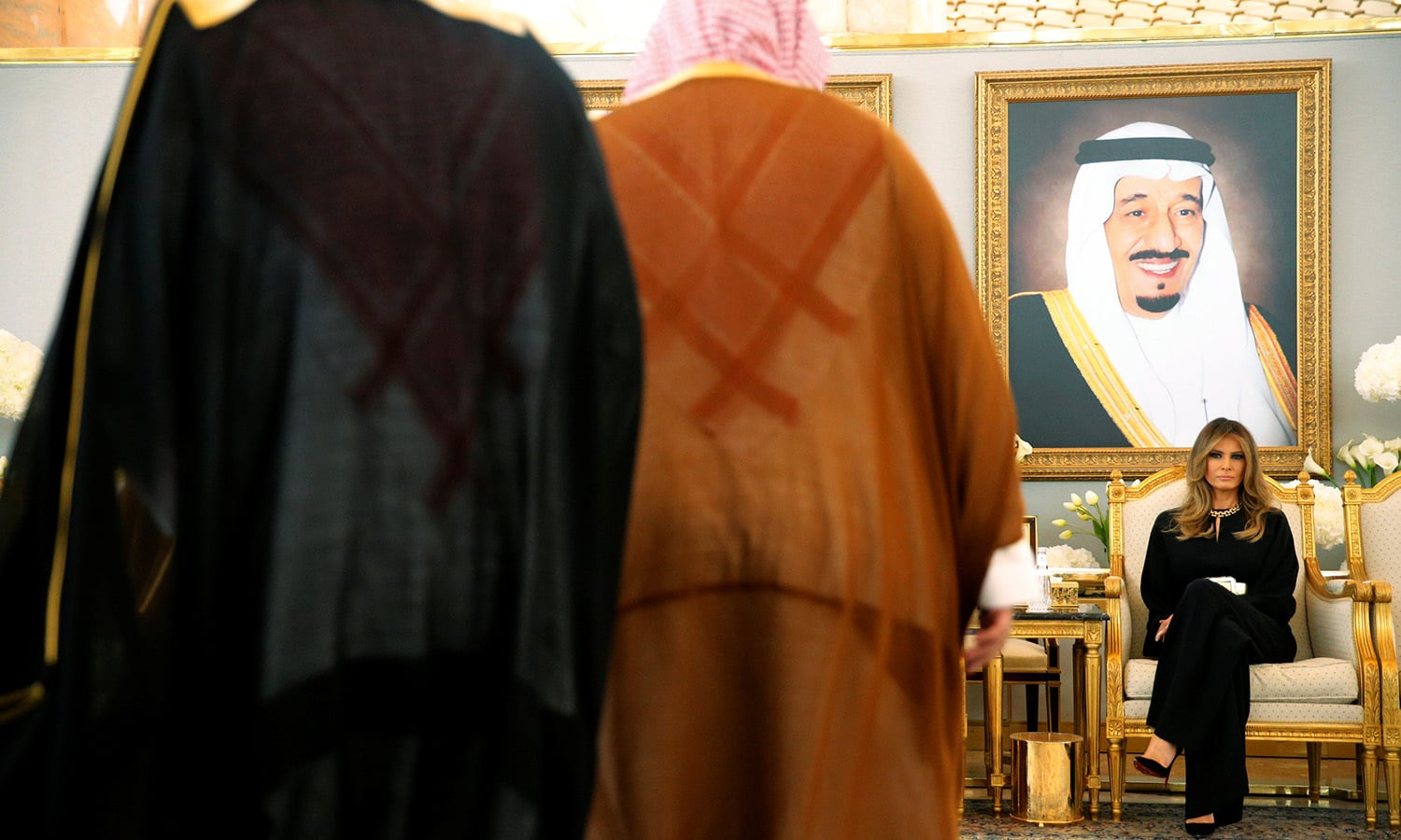 Melania looks on as the Saudi and US heads of state meet. ─ Reuters