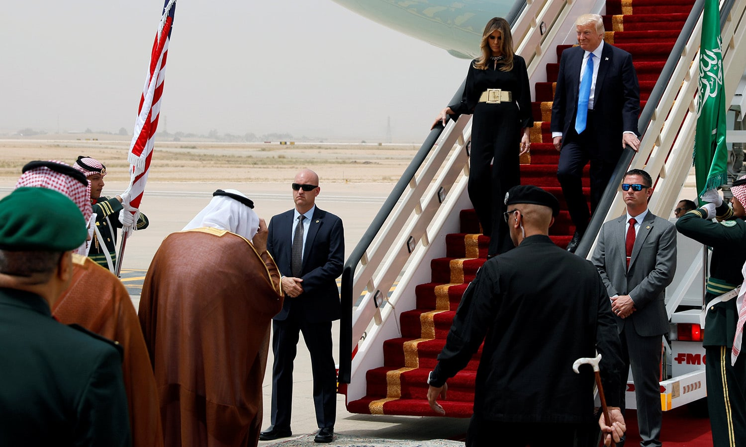 Saudi Arabia's King Salman bin Abdulaziz Al Saud (lower left, back to camera) welcomes US President Donald Trump and first lady Melania Trump as they arrive aboard Air Force One in Riyadh, May 20. ─ Reuters