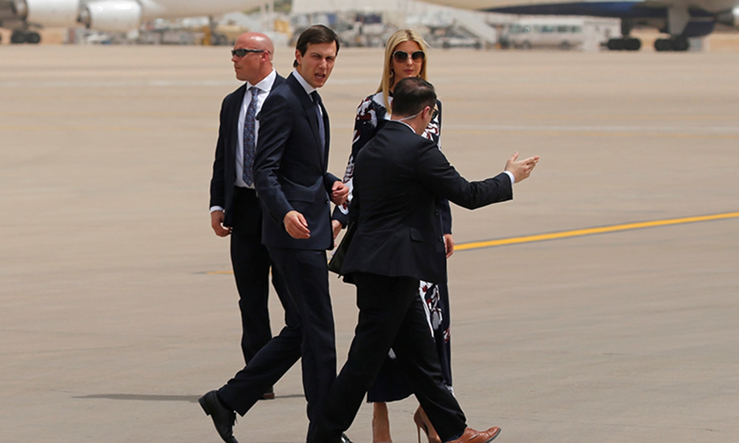 White House senior advisor Jared Kushner and his wife US first daughter Ivanka Trump being escorted by Saudi officials at the airport. ─ Reuters