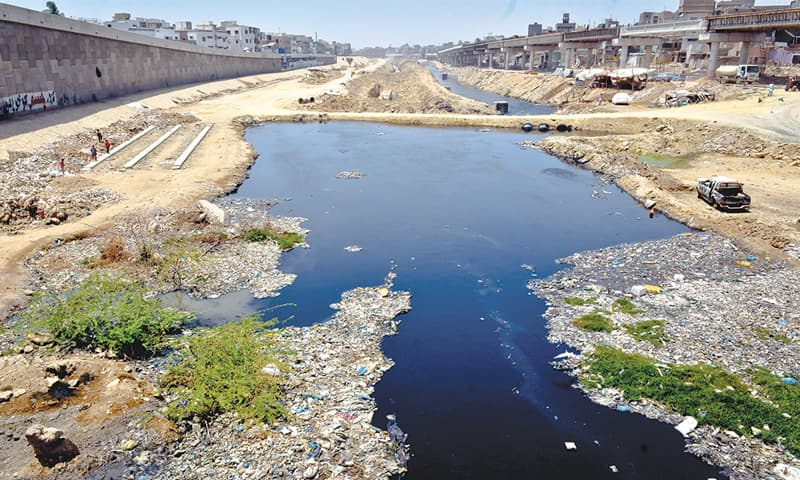 THE toxic Lyari River passes through a locality in Liaquatabad where people have set up their houses along the riverbank.—Fahim Siddiqi / White Star