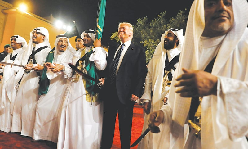 Riyadh: Saudi King Salman bin Abdulaziz Al Saud smiles approvingly as US President Donald Trump joins in a traditional sword dance welcome ceremony ahead of a banquet at Al Murabba Palace on Saturday.—Reuters