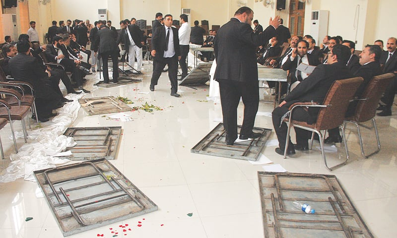 LAHORE: Participants of the lawyers convention gather in the Javed Iqbal Auditorium after the commotion on Saturday.—Photo by Murtaza Ali