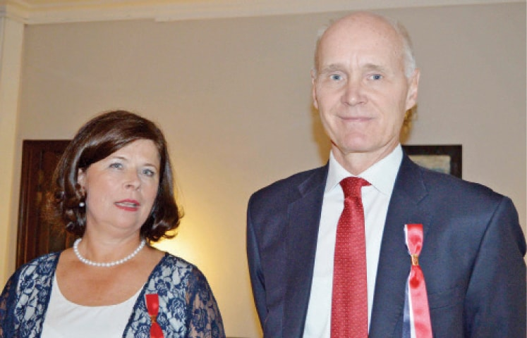 Ambassador Tore Nedrebo and his wife Anne Dessingthon welcome guests on the Norwegian  National Day at their residence in Islamabad.