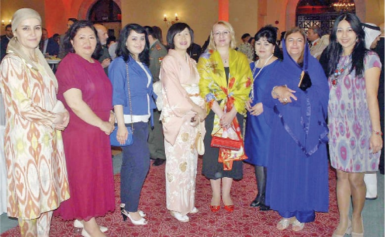 A group photo of Japanese ambassador's wife Rieko Kurai with spouses of other envoys during the Japan Self-Defence Day reception in Islamabad.