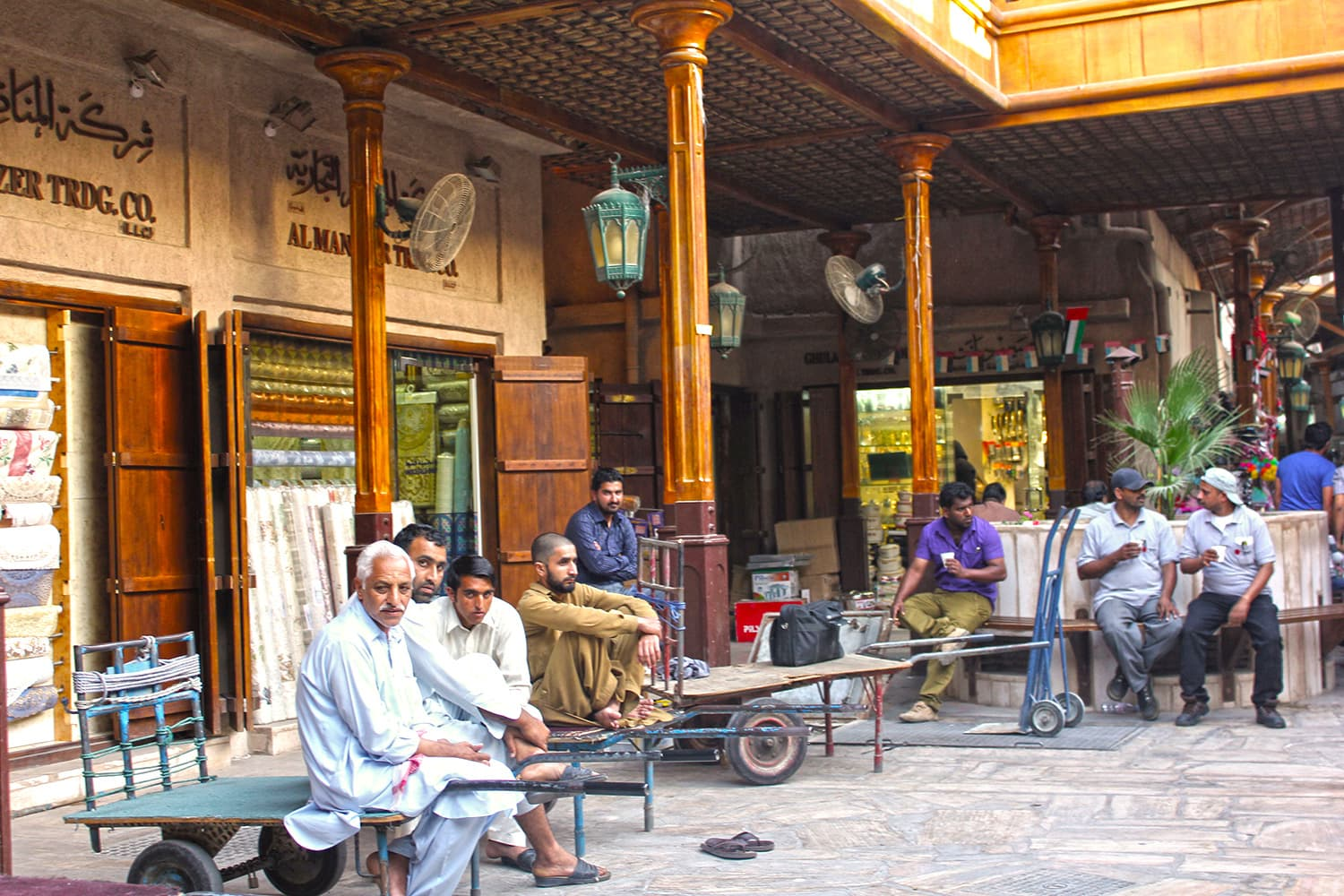 Pakistani and Indian workers socialise and have tea in one of the courtyards of Souk Al Kabeer in the Fahidi district.