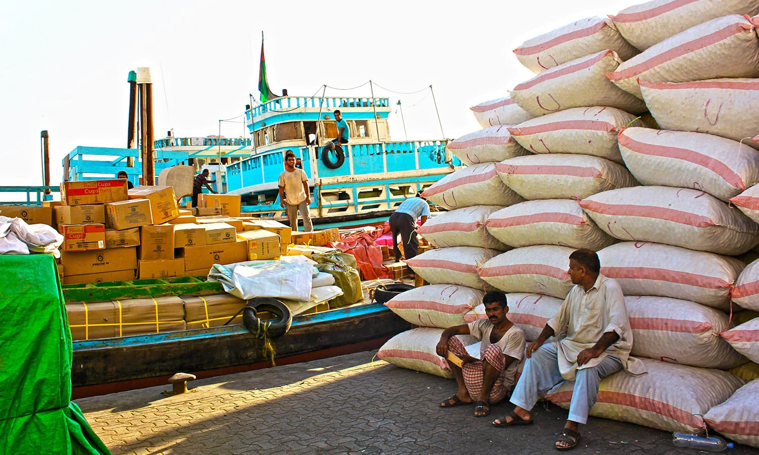 The old boats lined along the creek are always bustling with activity as workers unload products that are exported from around the world.