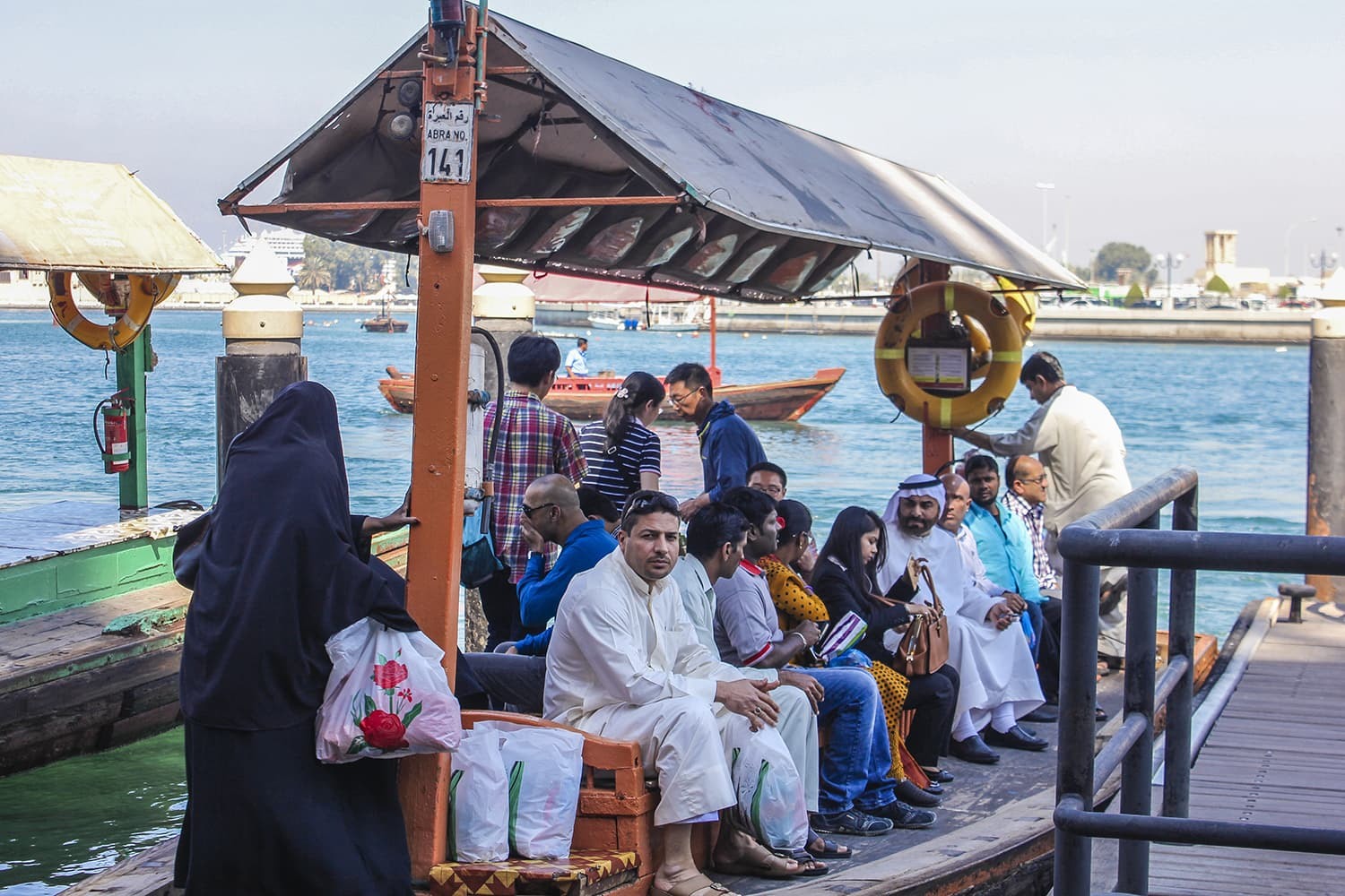 There is always a mix of people on the *abra* rides, which has stopovers across the entire Dubai Creek.