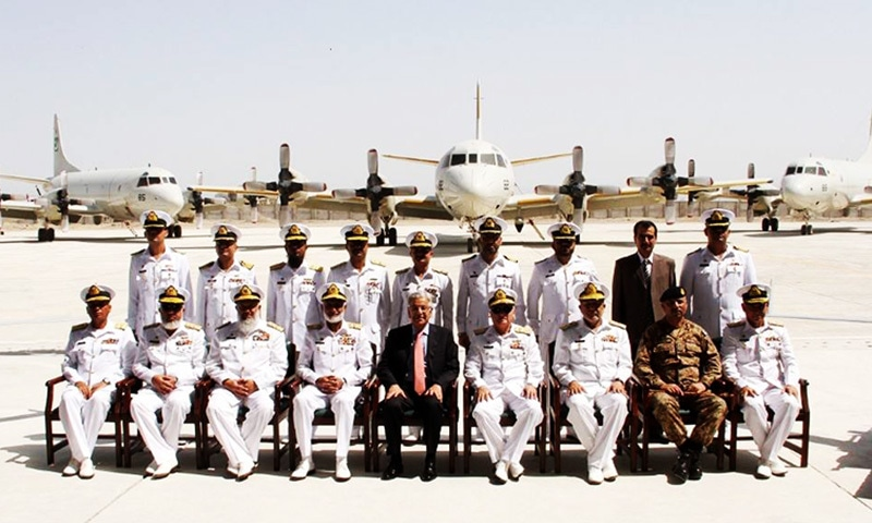 Minister for Defence Khawaja Asif and Chief of the Naval Staff, Admiral Zakaullah pose in a group photo at the station.—ISPR