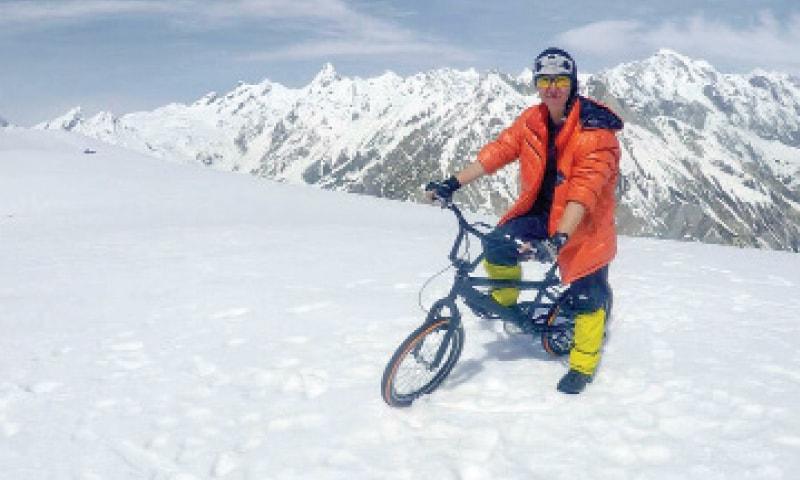Samar Khan on her bike at Burbucho peak in Baltistan. — Dawn